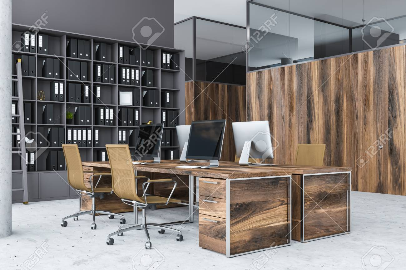 Corner Of Gray Office With Wooden Computer Tables With Brown