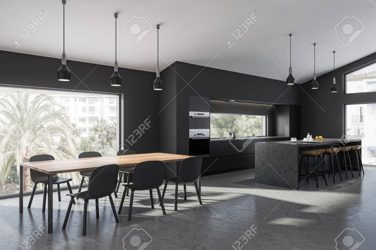 Corner of modern kitchen with gray walls, concrete floor, gray..
