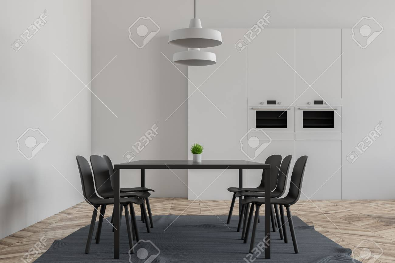 67bbb22bc9 Interior of stylish dining room with white walls, wooden floor, gray table  with chairs