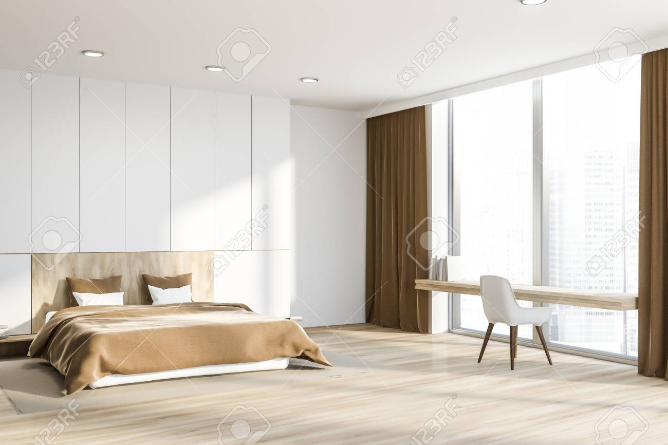 Corner of master bedroom with white walls, wooden floor, master..