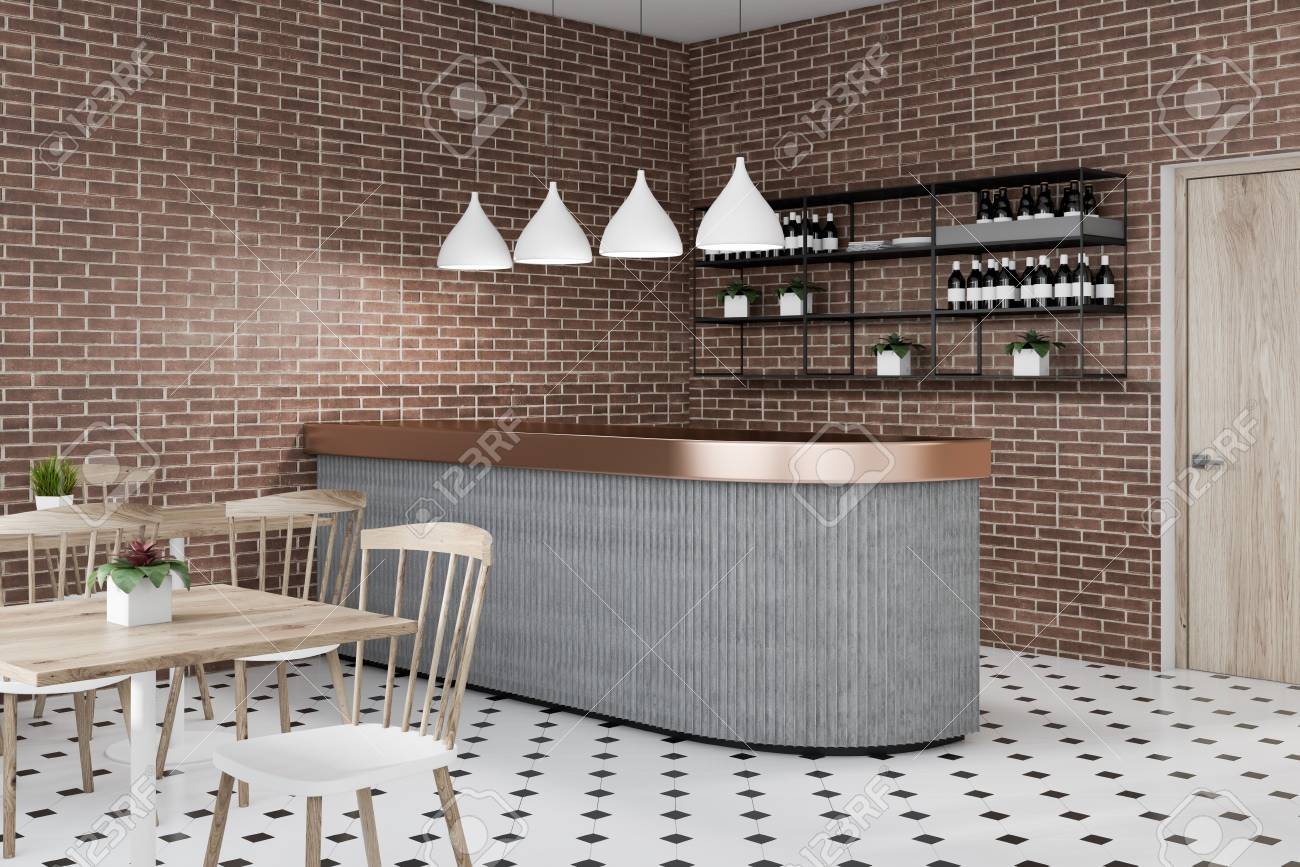 Corner of bar with brick walls, tiled floor, gray bar, shelves