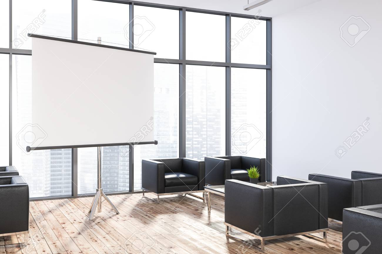 Modern Office Lounge Area With White Walls, Wooden Floor, Large Windows And  Black Armchairs