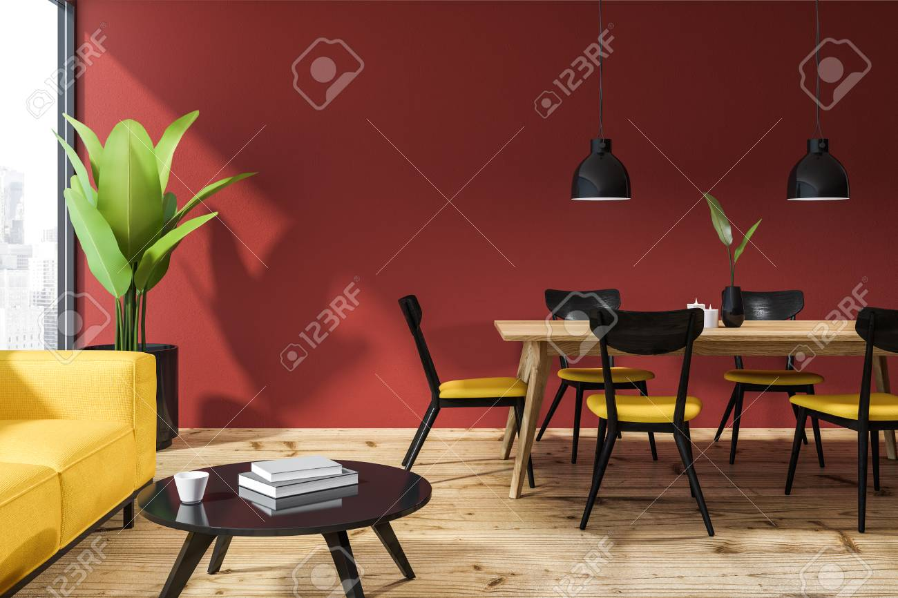 Interior of living room with red walls, wooden floor, yellow..