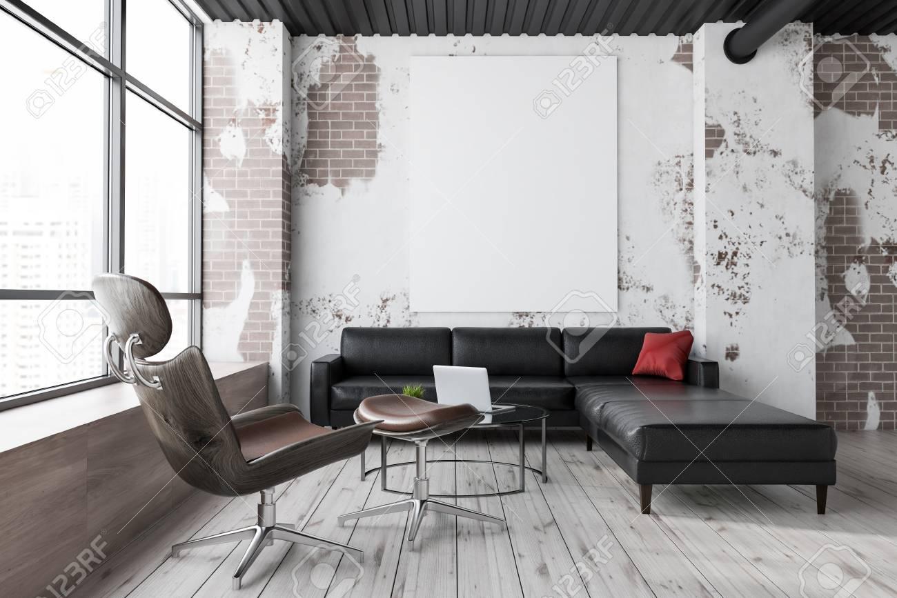 Grunge living room interior with brick walls, wooden floor, large..