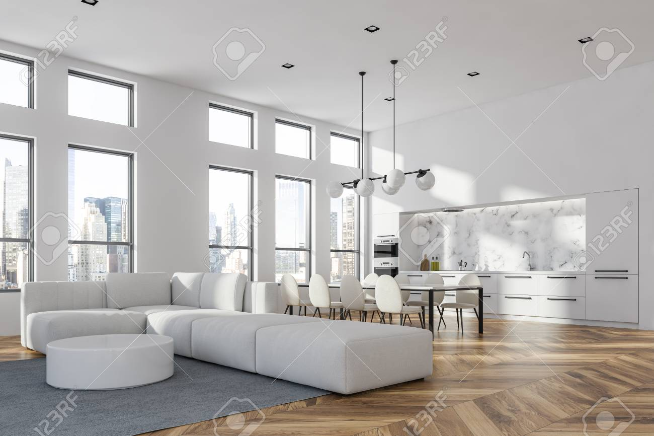 Corner of living room in modern studio apartment with white walls,..