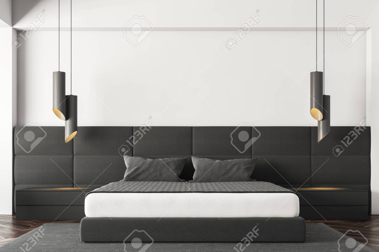 Interior Of Minimalistic Bedroom With White Walls Dark Wooden Stock Photo Picture And Royalty Free Image Image 115167709