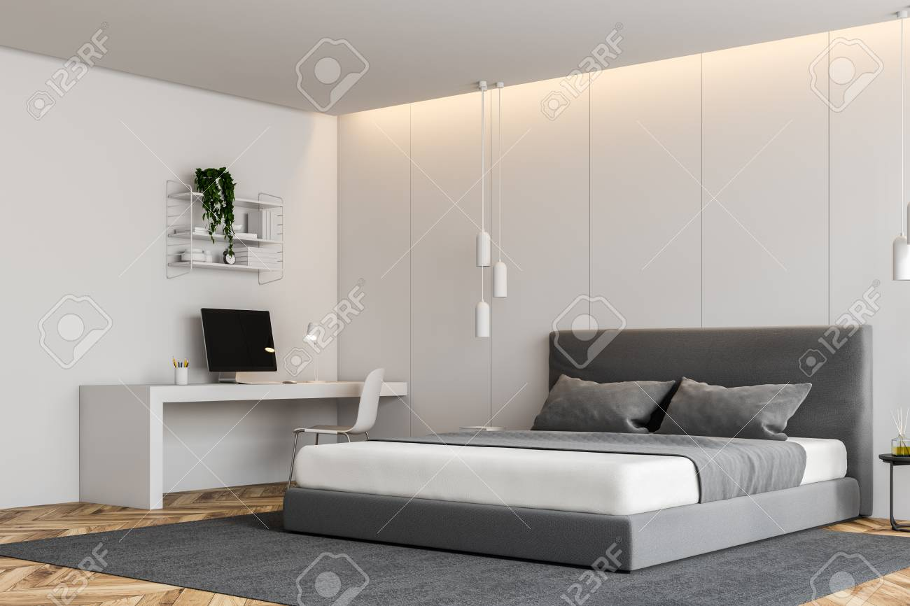 Corner of modern bedroom with white walls, wooden floor, gray..