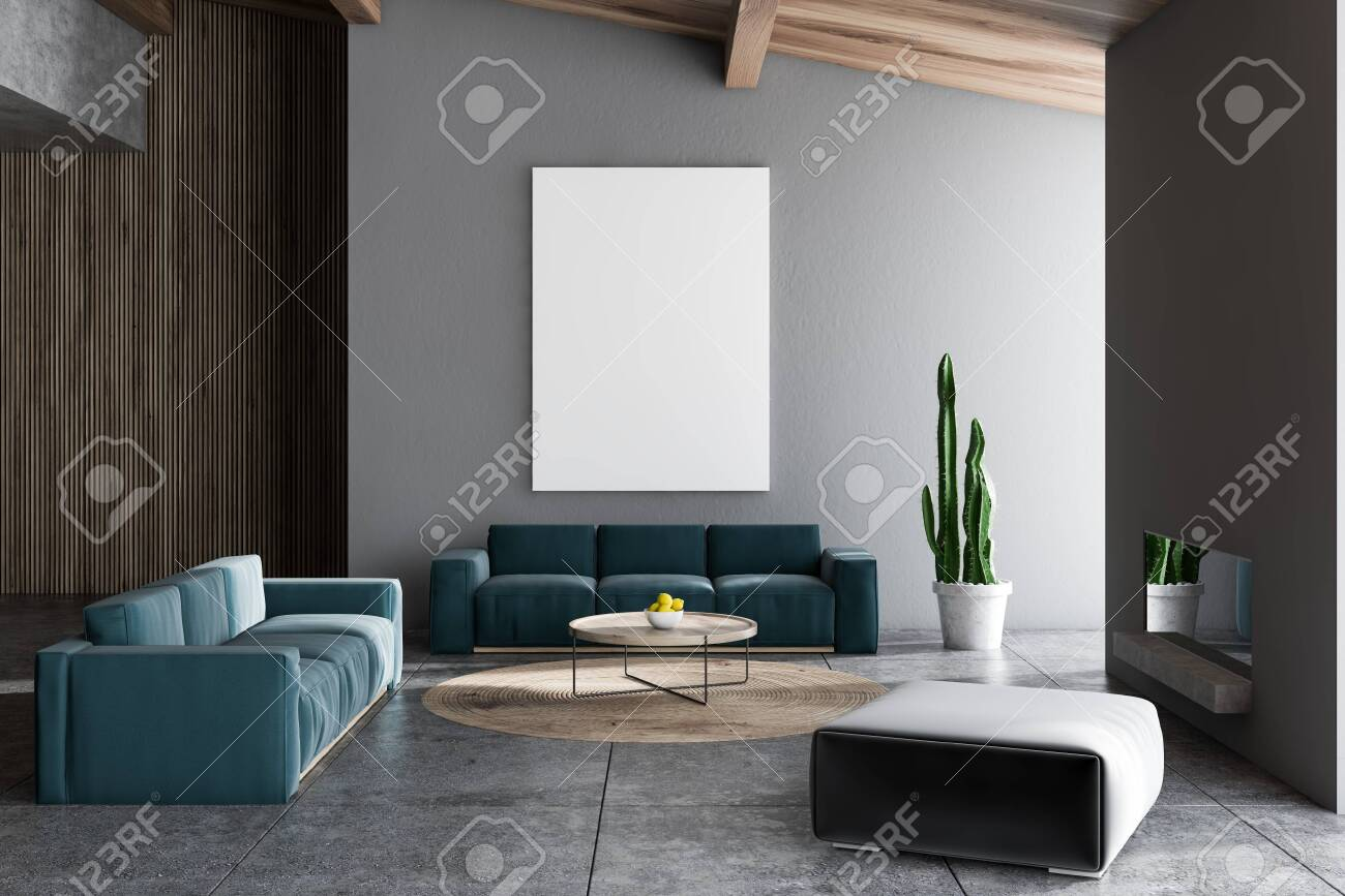 Interior of living room with gray and wooden walls, tiled floor,..
