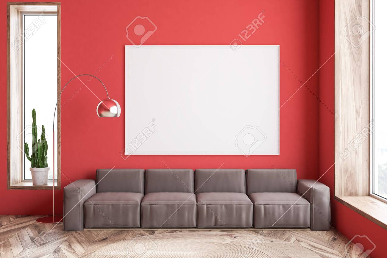 Interior of modern living room with red walls, wooden floor and..