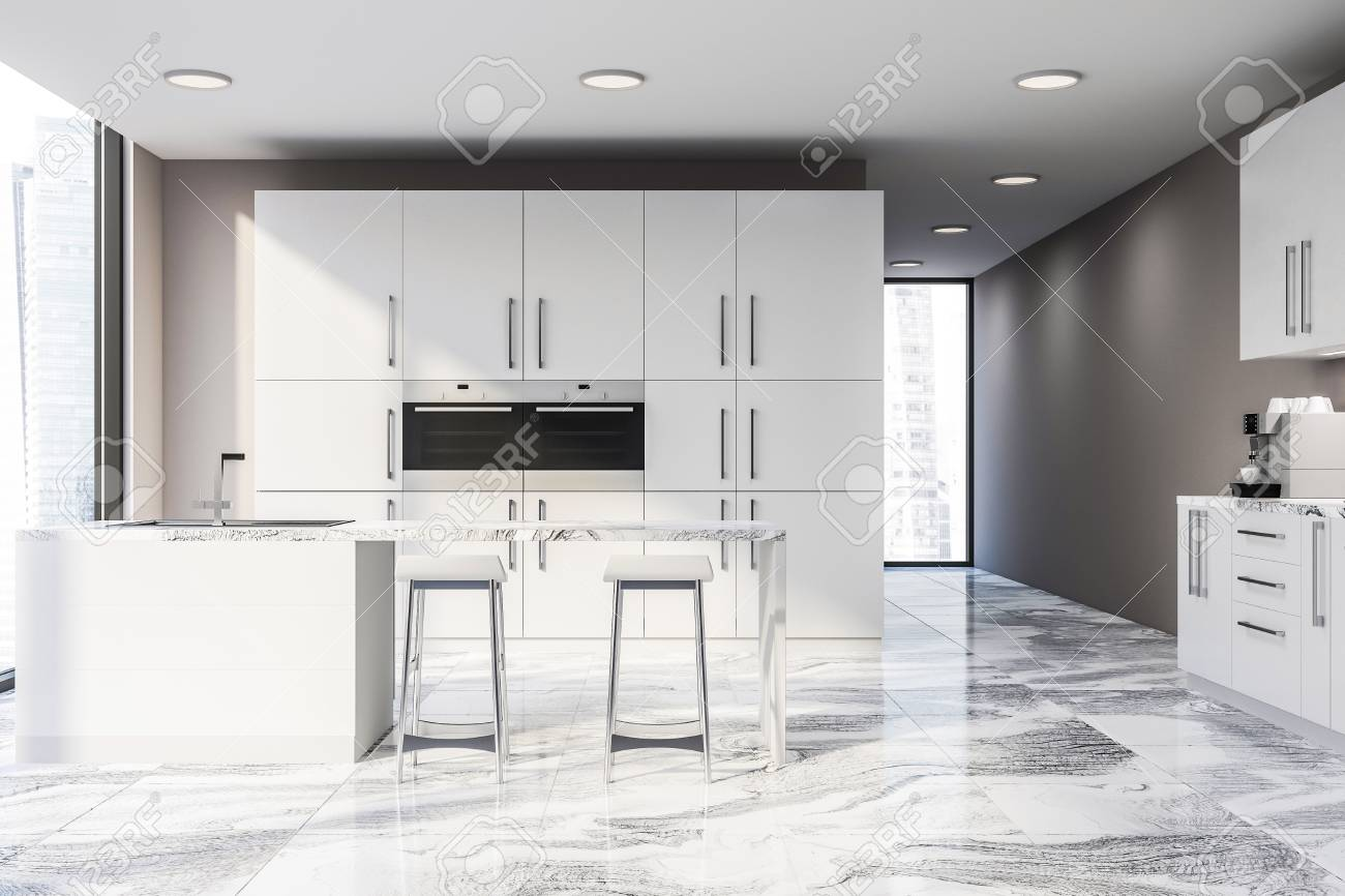 Interior Of Modern Kitchen With Beige Walls Marble Floor White Stock Photo Picture And Royalty Free Image Image 117068582