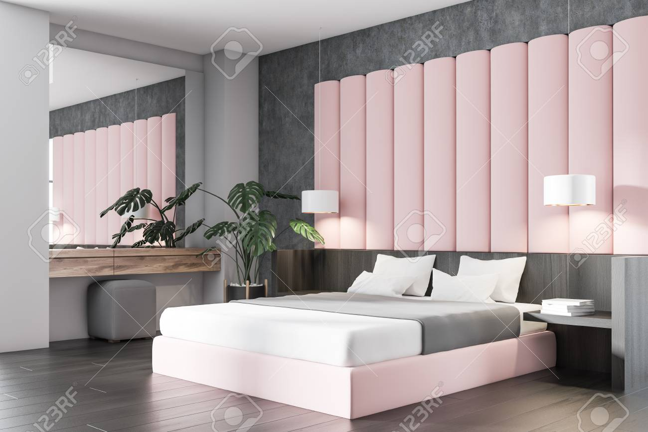 Corner of stylish bedroom with concrete, gray and pink walls,..