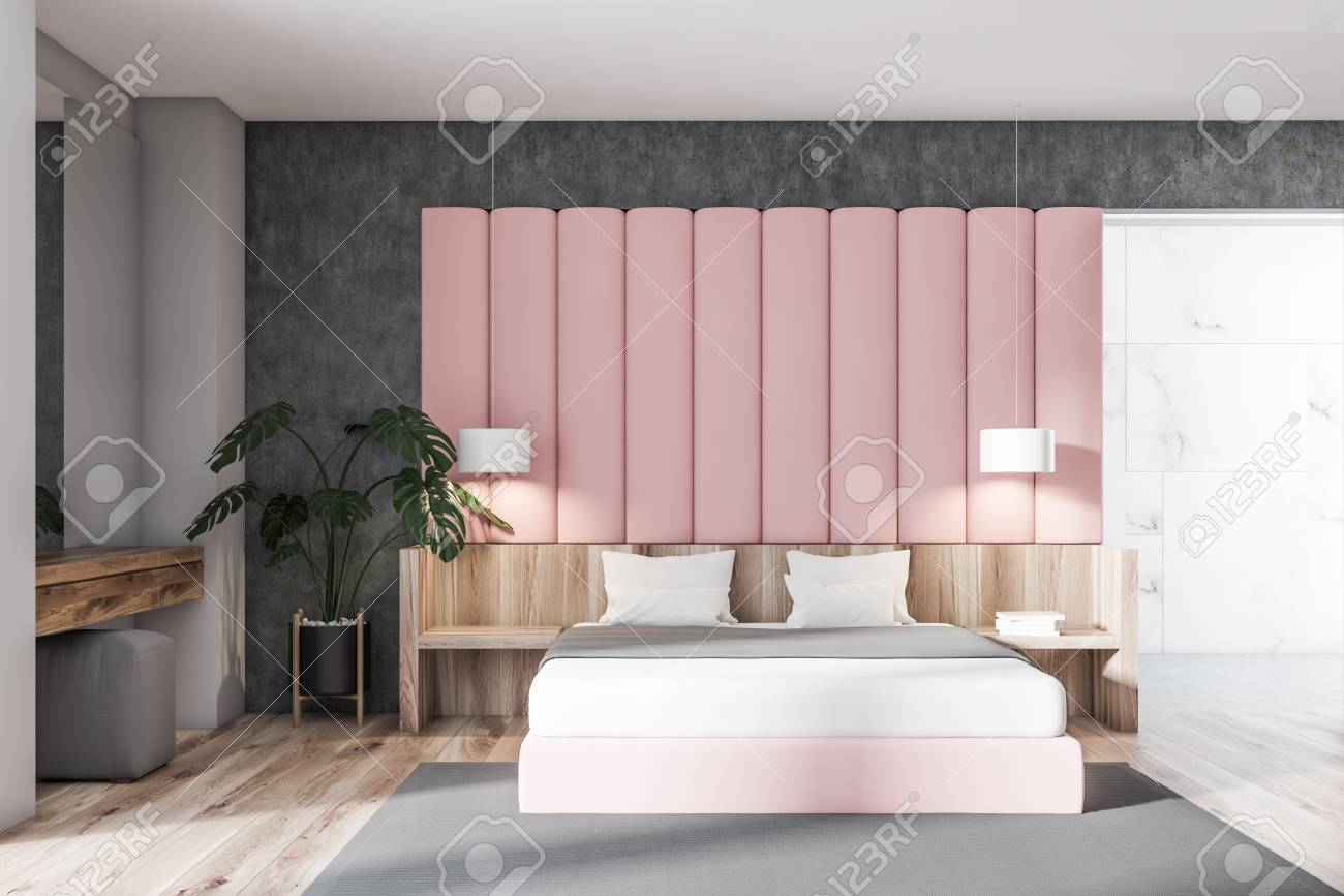 Interior of stylish bedroom with concrete, gray and pink walls,..