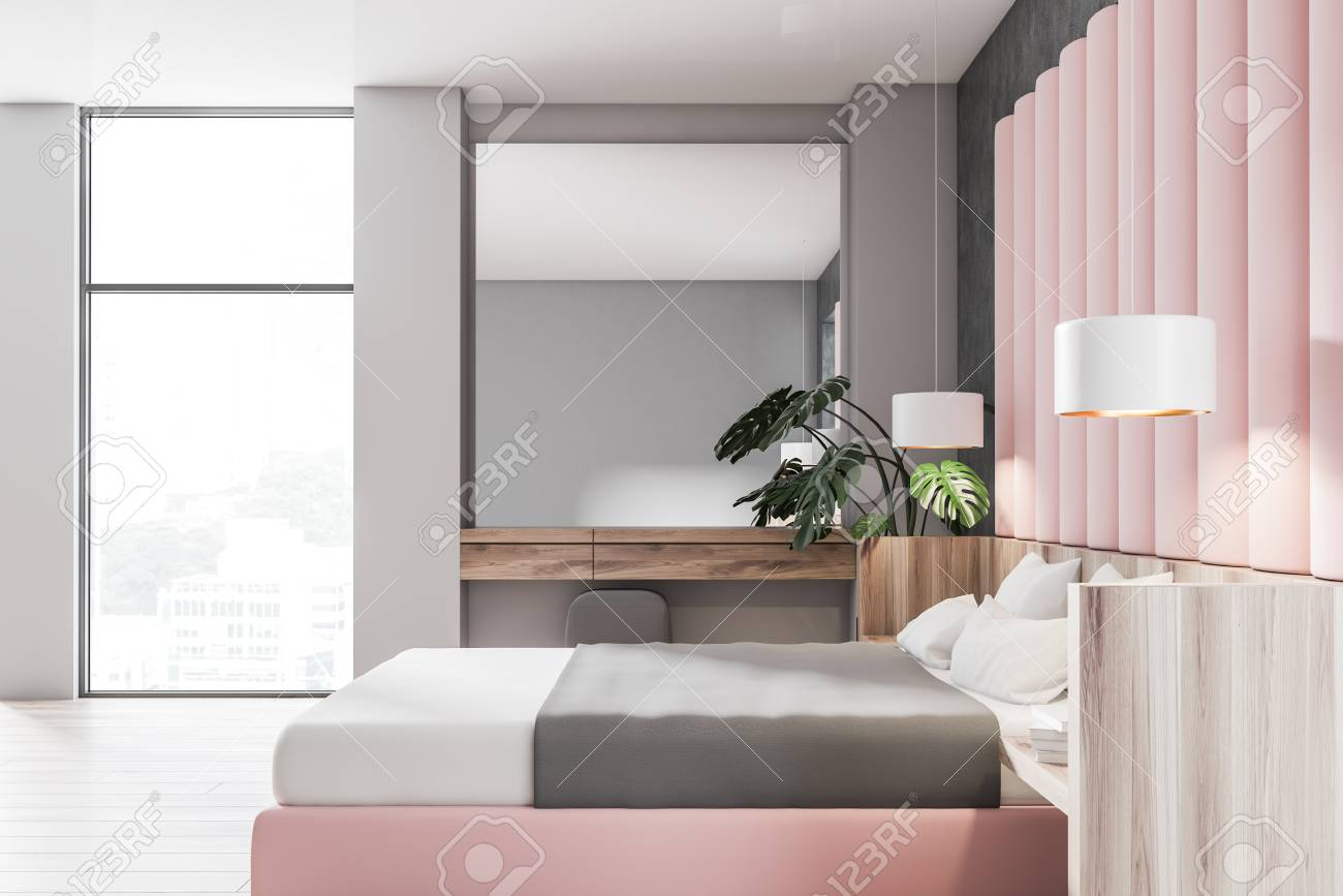 Side view of stylish bedroom with gray and pink walls, wooden..
