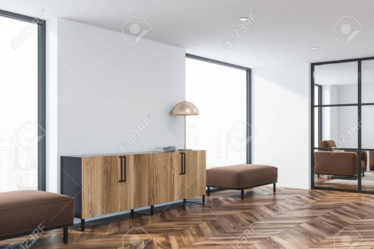 Corner of modern living room with white walls, wooden floor,..