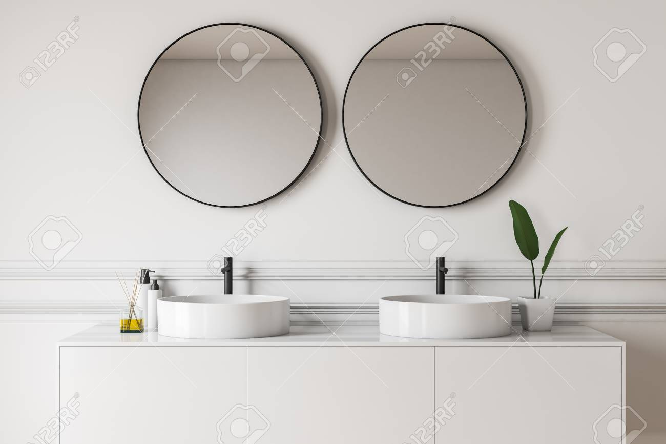 Close Up Of Luxury Bathroom With White Walls Double Sink Standing Stock Photo Picture And Royalty Free Image Image 118420545