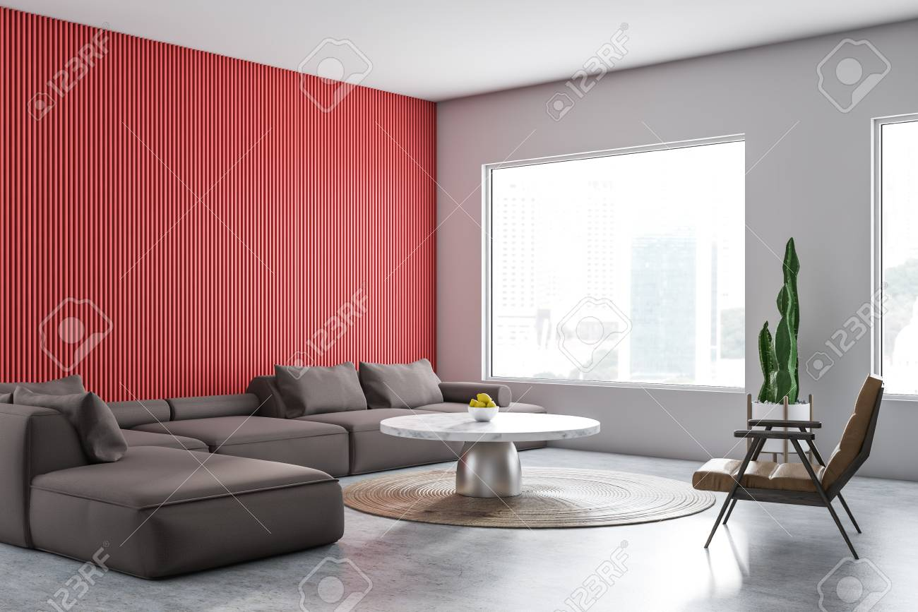 Corner of comfortable living room with white and red walls, concrete..
