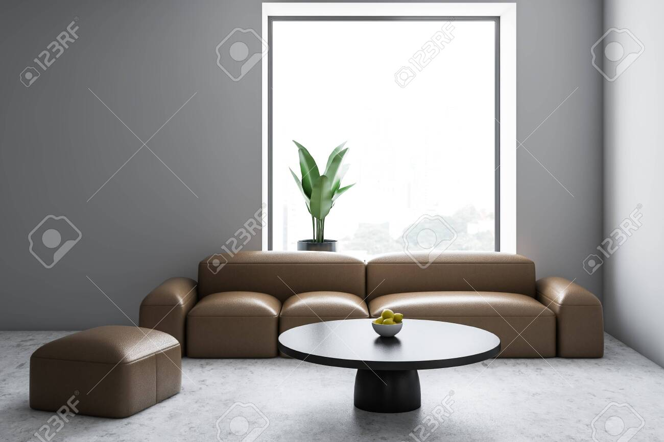Interior of modern living room with white walls, concrete floor,..