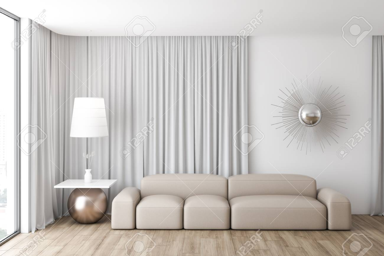 Interior of modern living room with white walls, large windows..