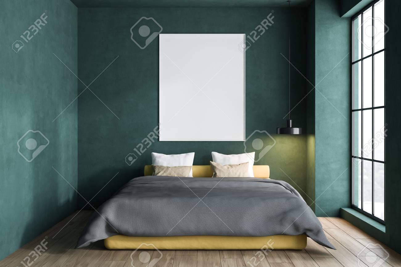 Interior of minimalistic bedroom with green walls, wooden floor,..
