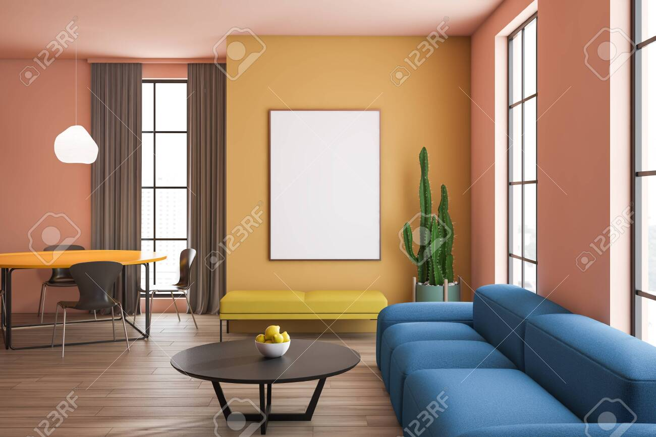 Stylish living room interior with blue sofa and yellow bench..