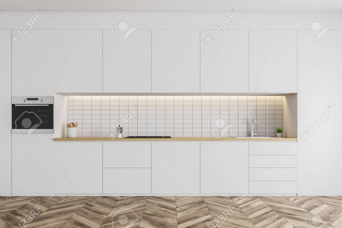 Minimalistic White Kitchen Interior With Tiled Walls Wooden