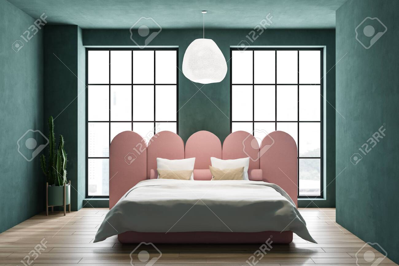 Interior of stylish bedroom with green walls, wooden floor, large..