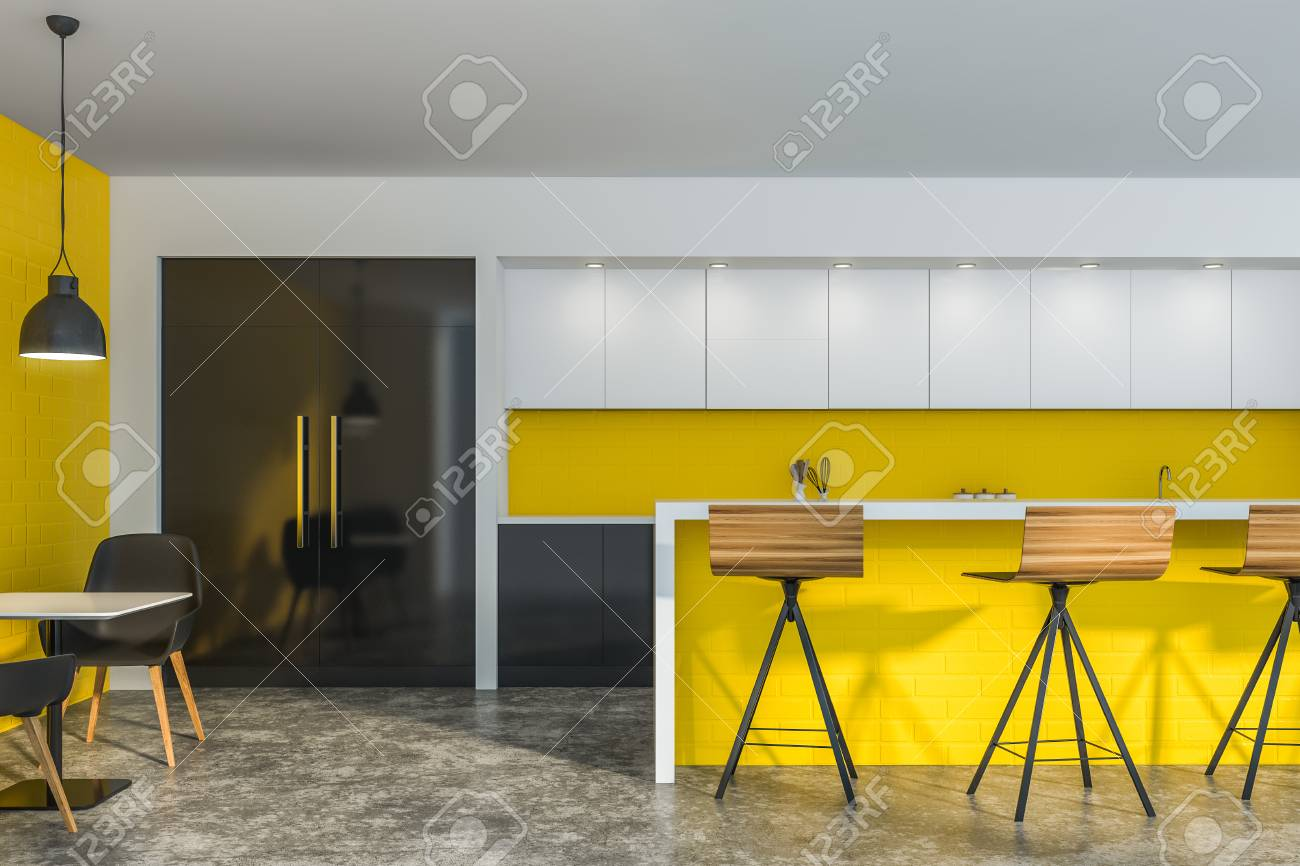 Bright Yellow Cafe Interior With Brick Walls Yellow Bar Counter Stock Photo Picture And Royalty Free Image Image 121455285