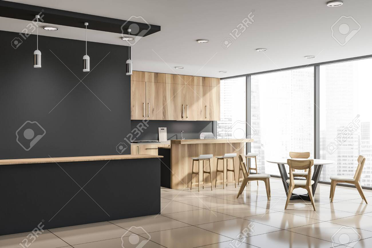 Large gray bar counter with lamps above it in modern kitchen..