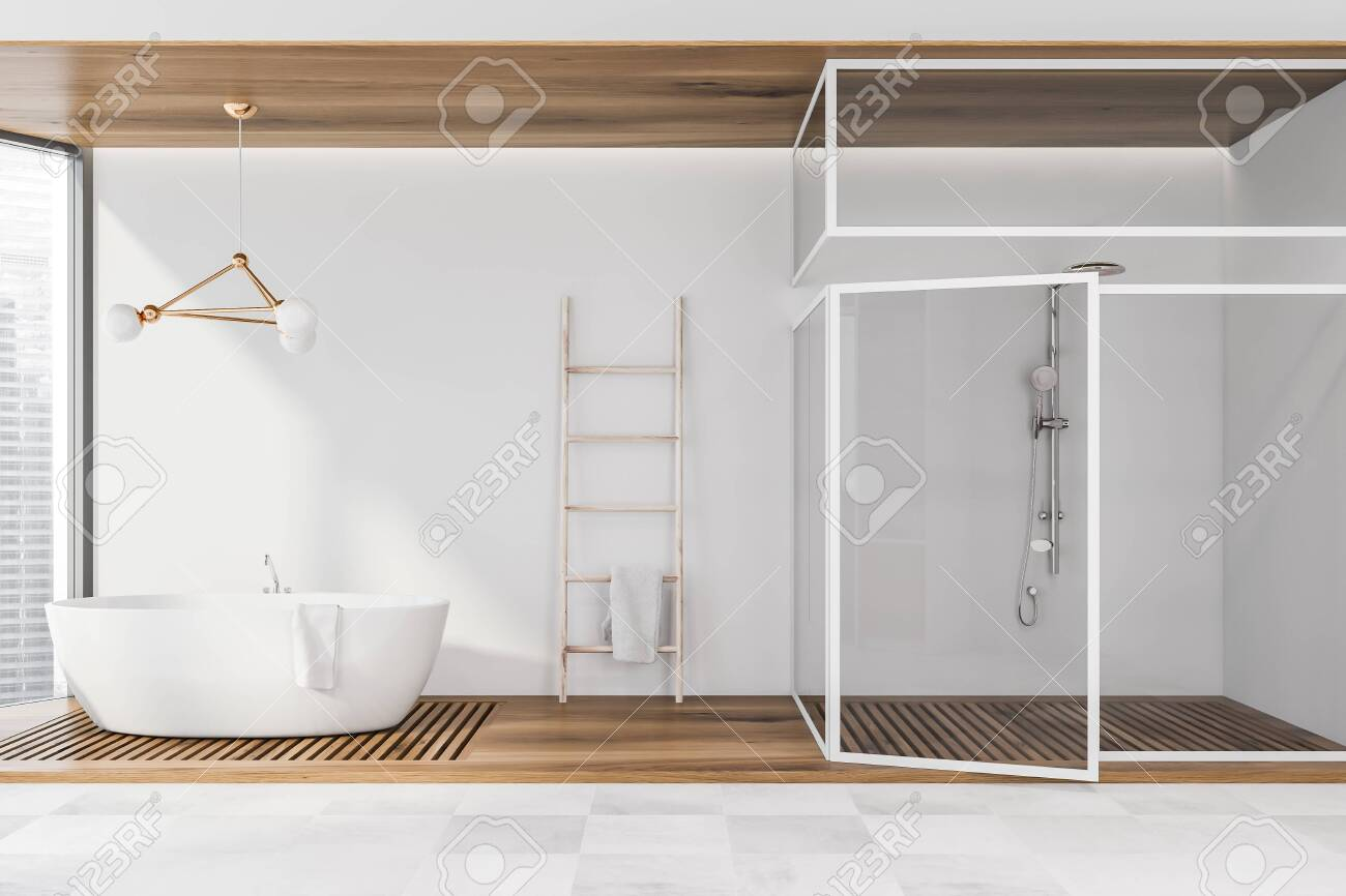 Interior Of Spacious Bathroom With White Walls Tiled Floor