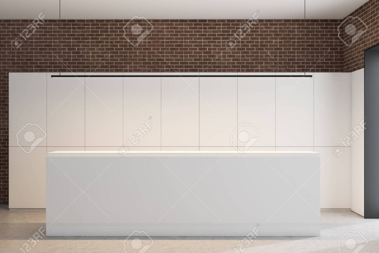 White reception desk standing in modern office with white and..