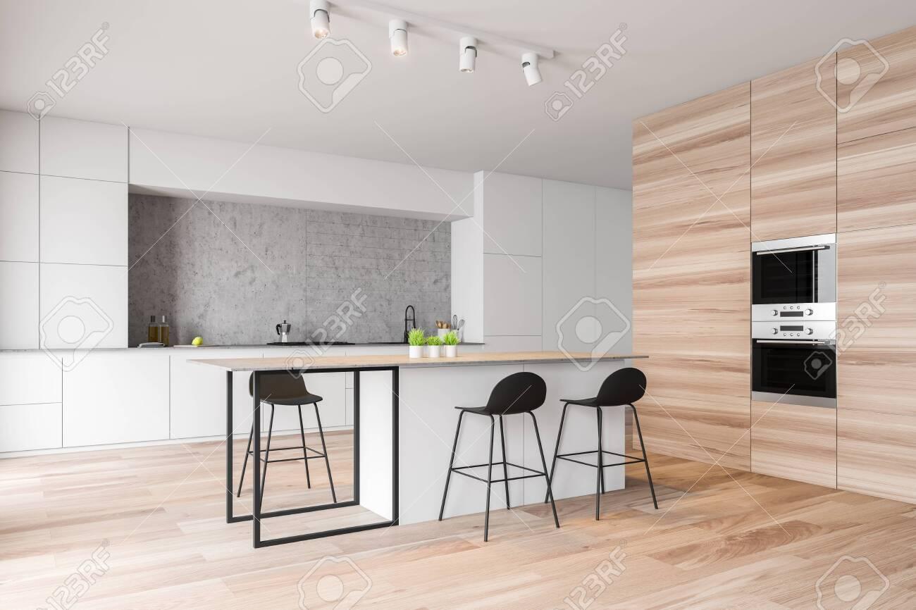 Corner of modern kitchen with concrete walls, wooden floor, white..