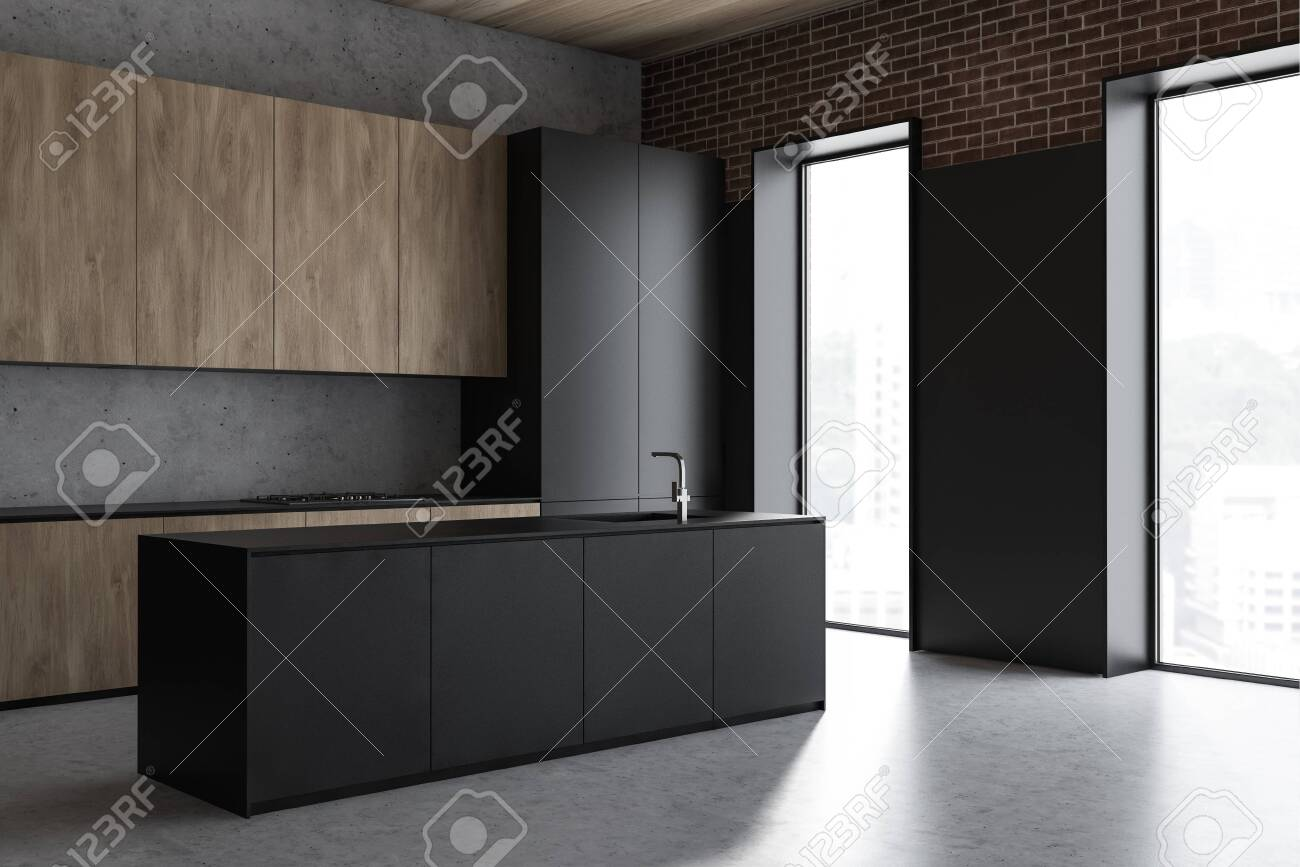 Corner of loft kitchen with concrete and brick walls, stone floor,..