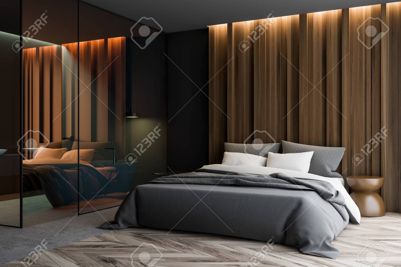 Corner of master bedroom with gray and wooden walls, gray bed..