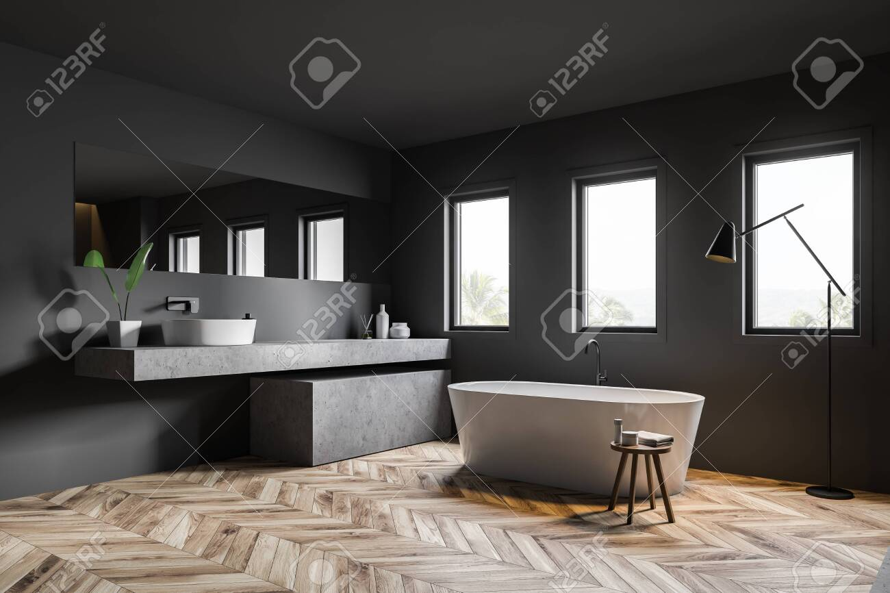 Corner Of Dark Gray Bathroom With Wooden Floor White Bathtub Stock Photo Picture And Royalty Free Image Image 124086447