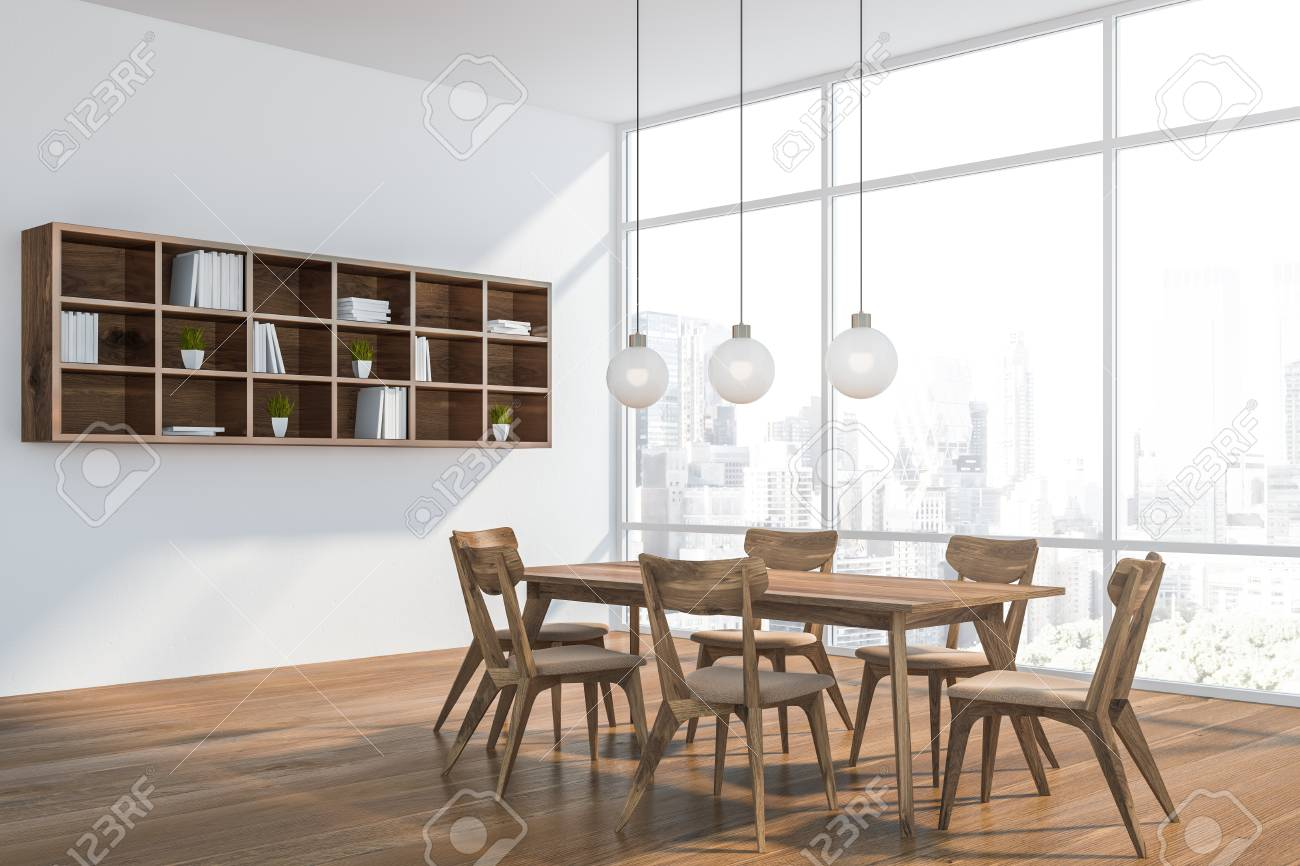 Corner Of Modern Dining Room With White Walls Wooden Floor