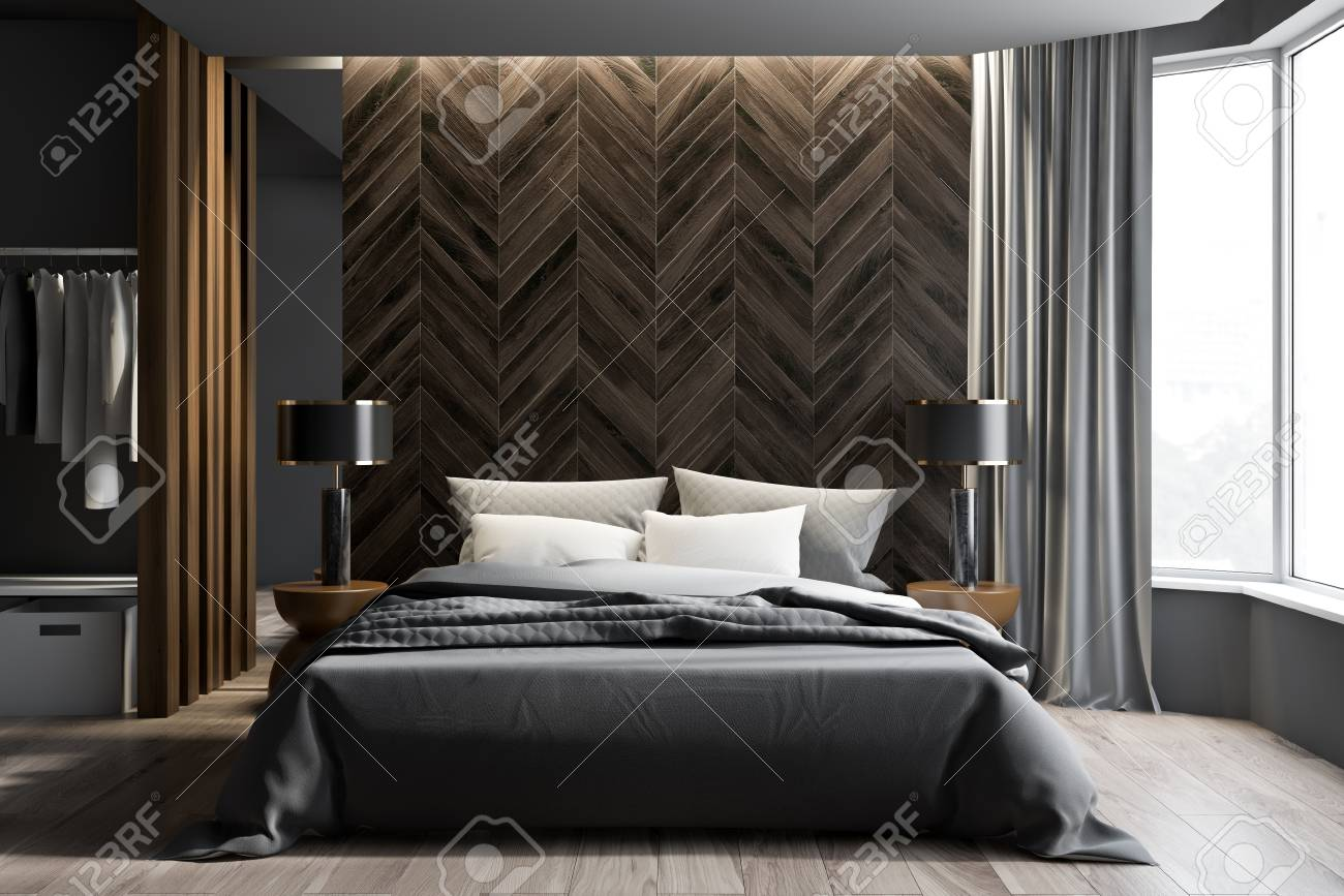 Interior of modern bedroom with gray and dark wooden walls, wooden..