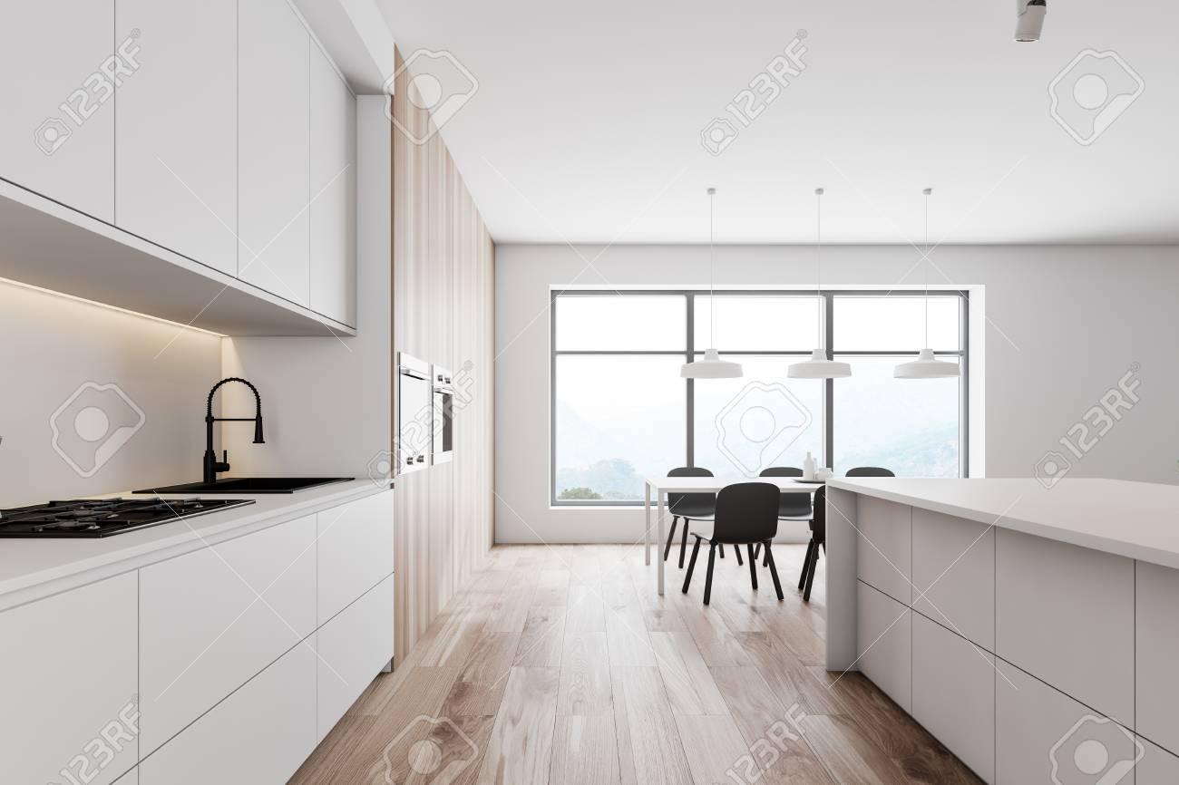Side view of modern kitchen with white walls, wooden floor, white..