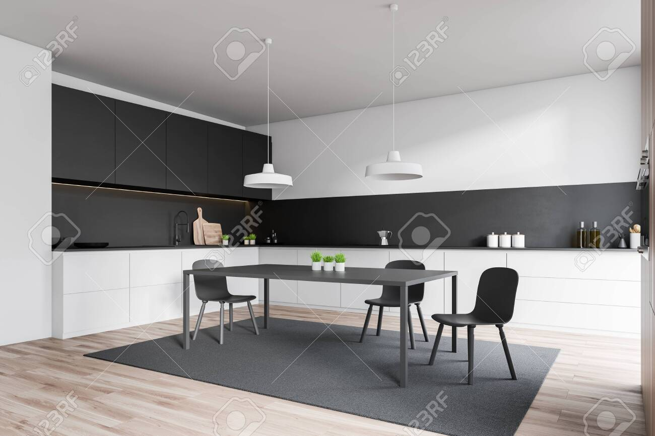 Corner Of Stylish Kitchen With White And Black Walls Wooden Stock Photo Picture And Royalty Free Image Image 124973123