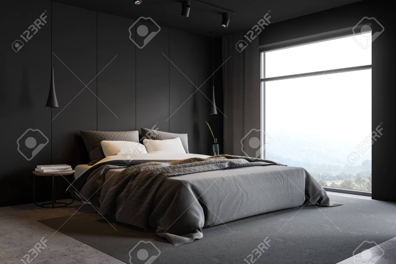 Corner of stylish master bedroom with gray walls, concrete floor,..