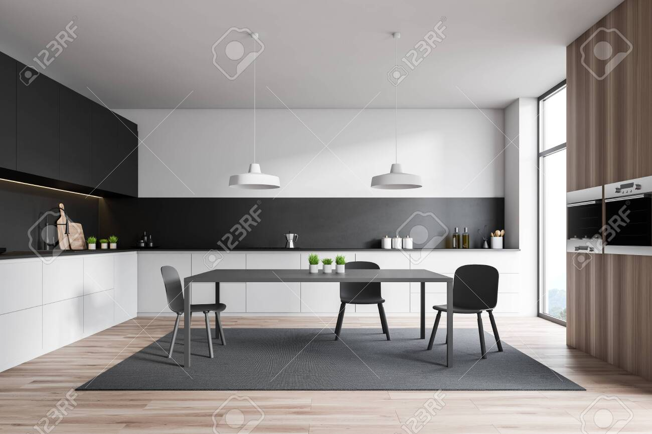 Interior Of Stylish Kitchen With White And Black Walls Wooden Stock Photo Picture And Royalty Free Image Image 124974706