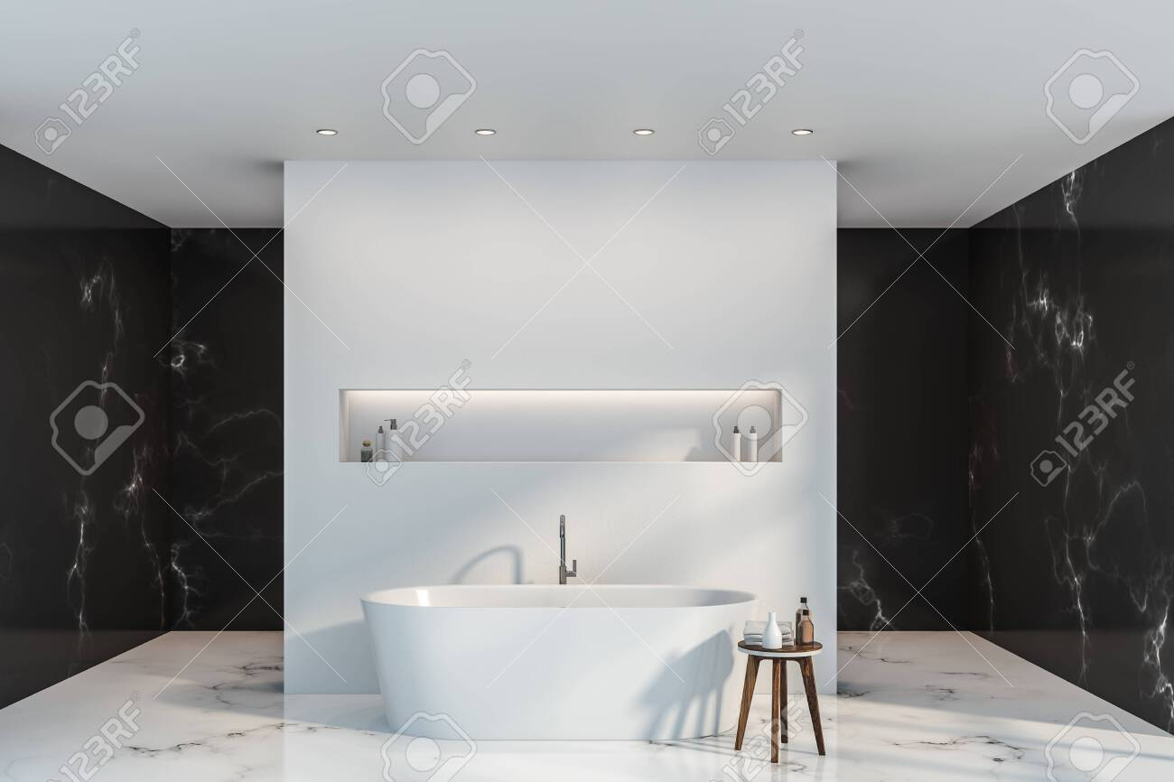 Interior Of Luxury Bathroom With Black Marble And White Walls