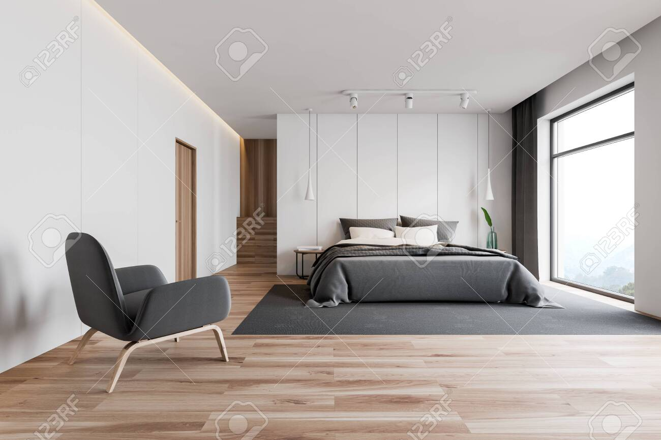 Interior Of Stylish Master Bedroom With White Walls Wooden Floor Stock Photo Picture And Royalty Free Image Image 126509373