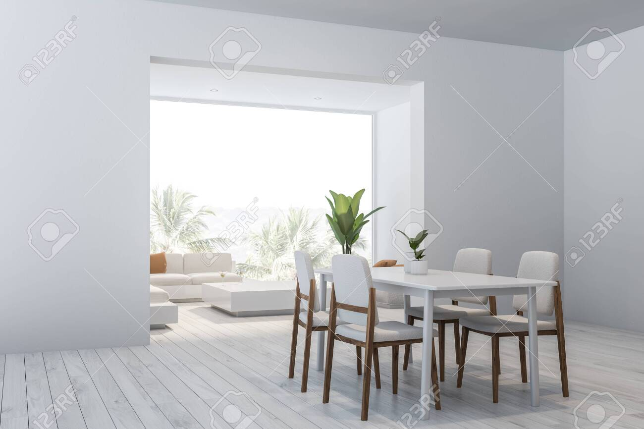 Corner Of Modern Dining Room And Living Room With White Walls