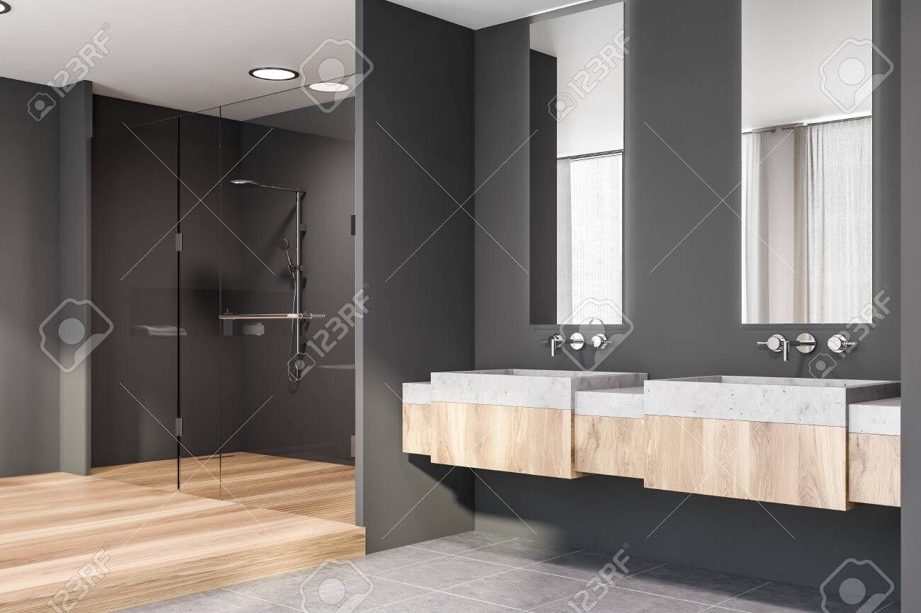 Corner Of Modern Bathroom With Grey Walls Tiled And Wooden Floor Stock Photo Picture And Royalty Free Image Image 128362657