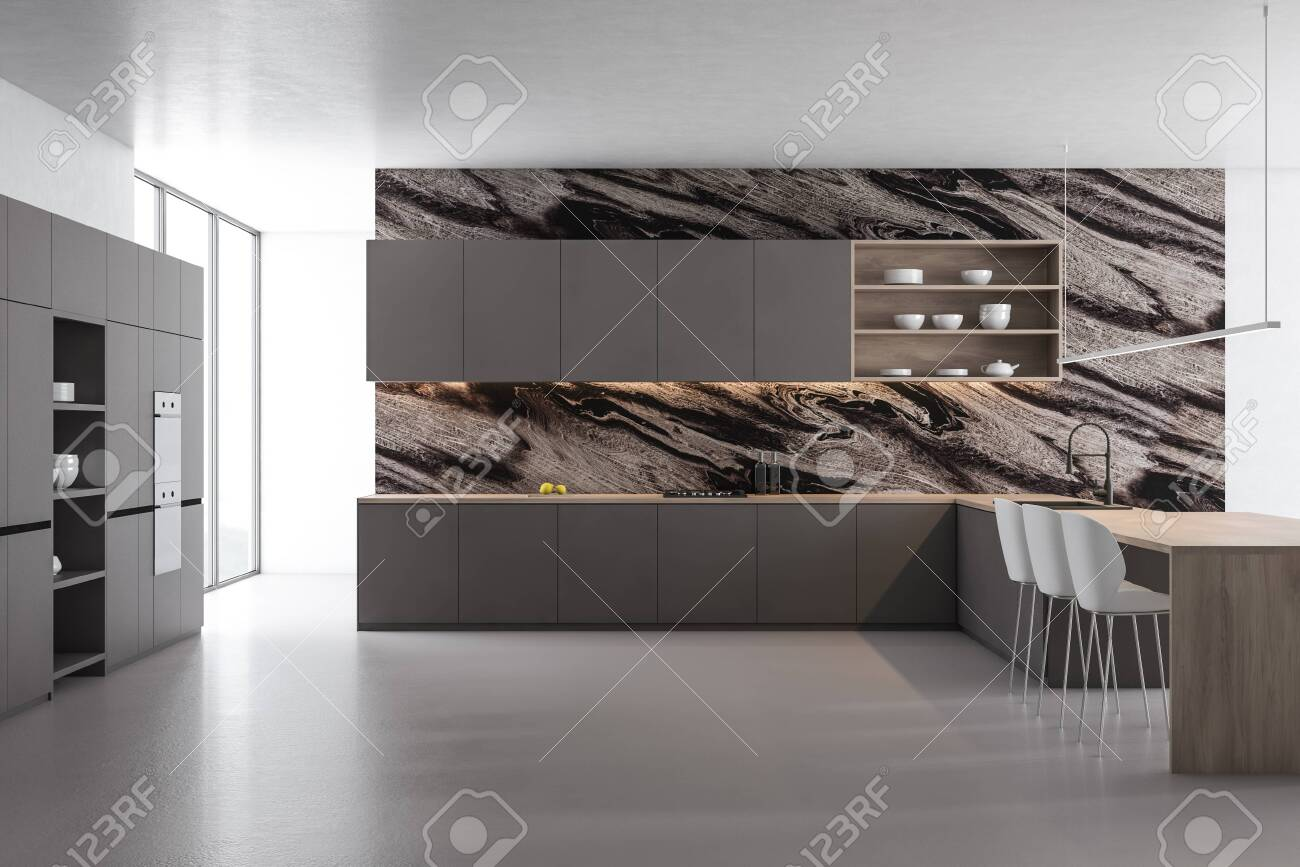 Interior Of Modern Kitchen With Black Marble Walls Concrete Stock Photo Picture And Royalty Free Image Image 127267618