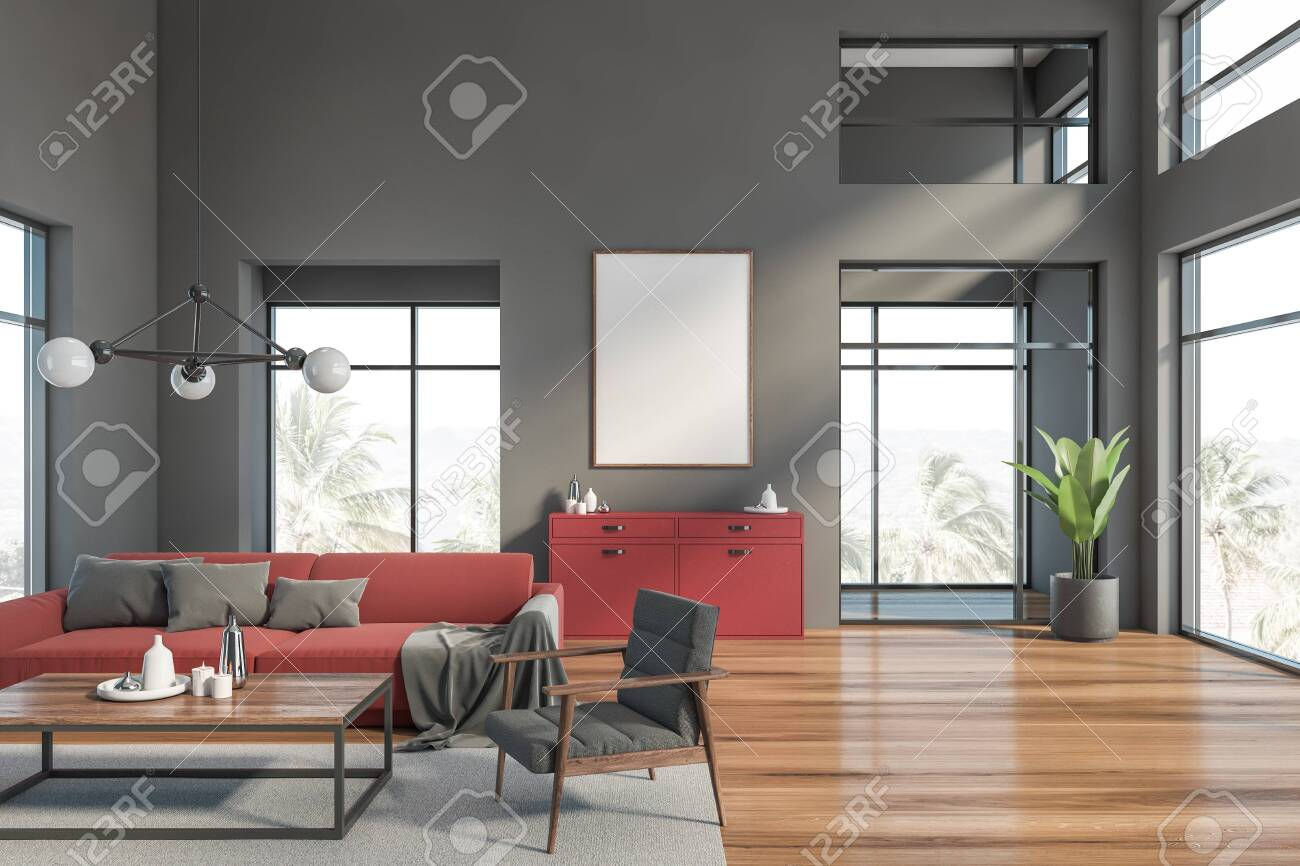 Interior of modern living room with gray walls, wooden floor,..