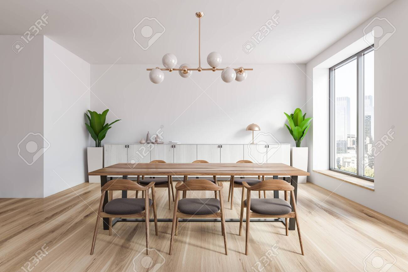 Picture of: Interior Of Stylish Dining Room With White Walls Wooden Floor Stock Photo Picture And Royalty Free Image Image 127788945