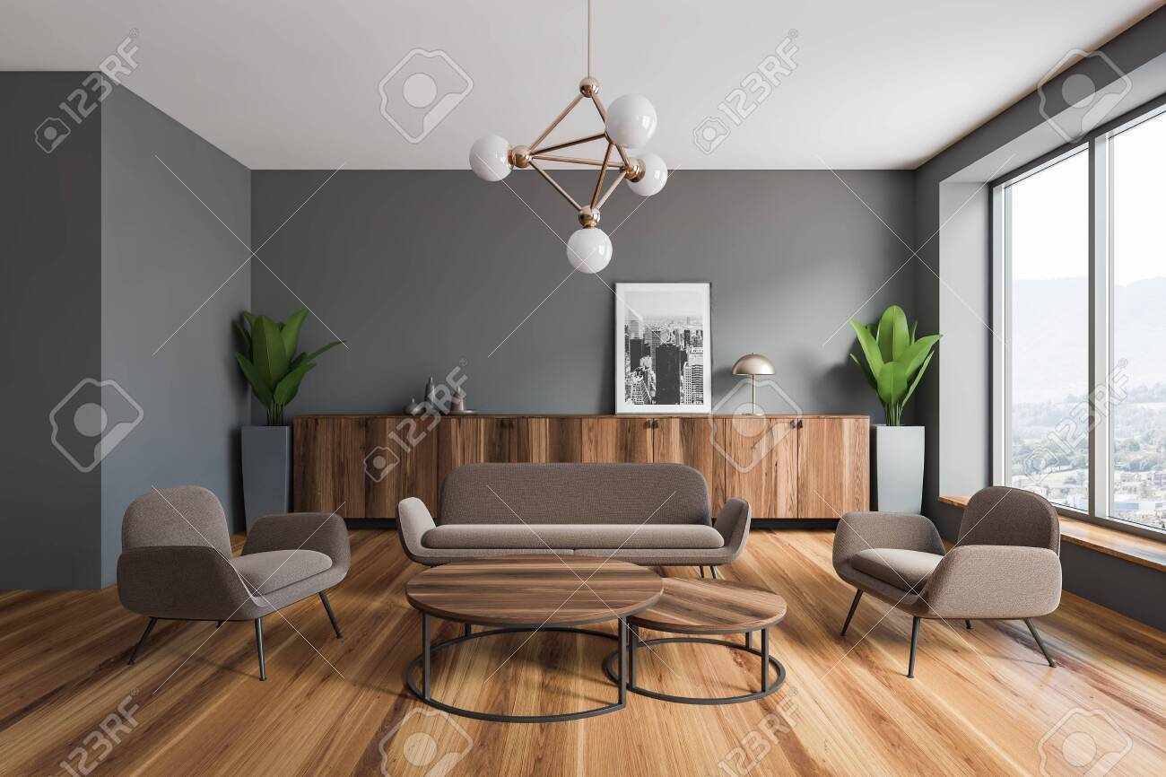 Interior of modern living room with gray walls, wooden floor,..