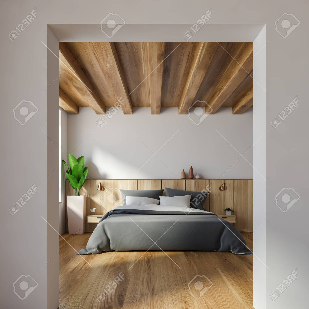 Interior of stylish bedroom with white walls, wooden floor, double..