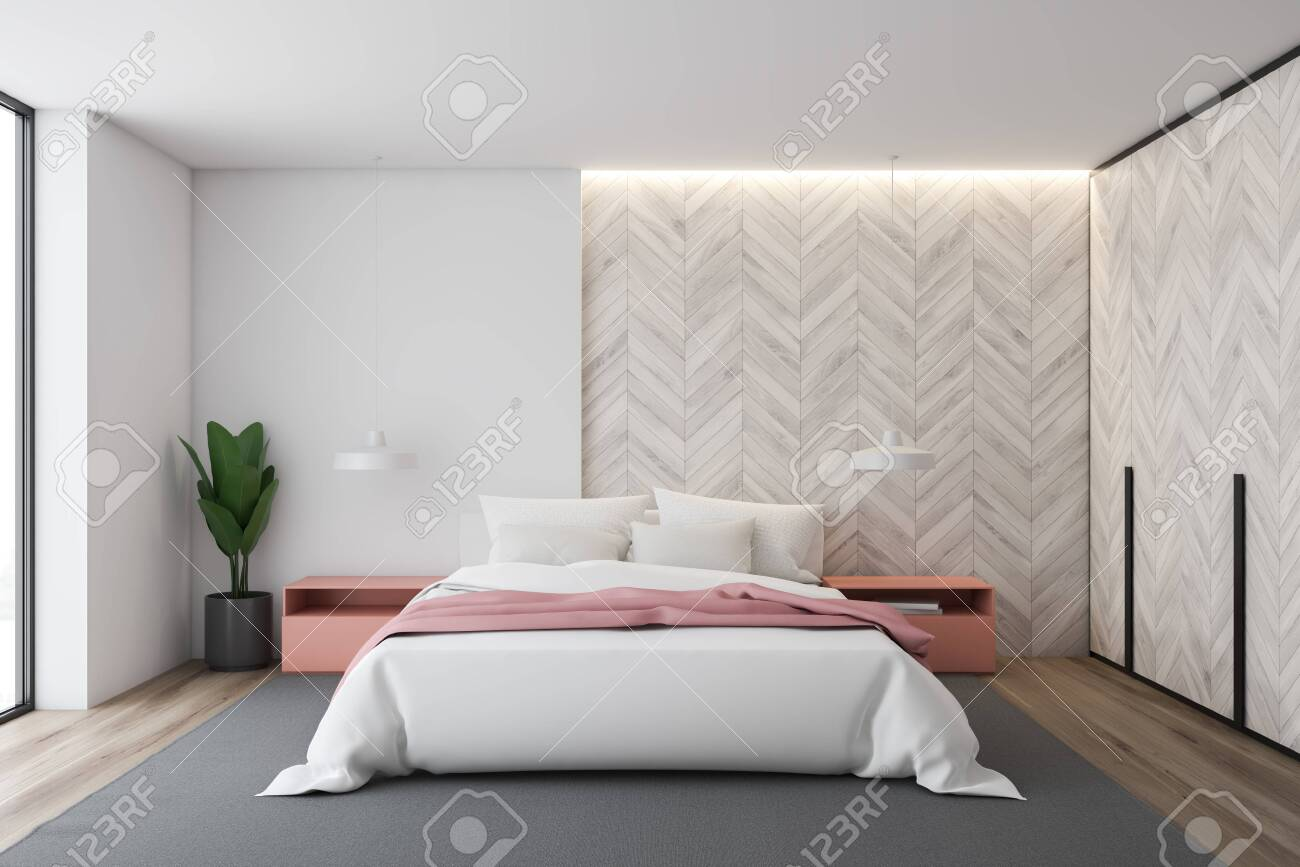 Interior of stylish bedroom with white and light wooden walls,..